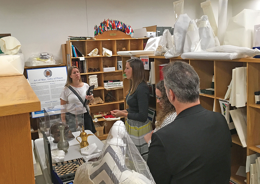 Freelance writer Anne Kniggendorf, left, explores the CGSC art and gift collection with reps from the Todd Weiner Gallery Aug. 15. From left, Kniggendorf, Meghan Dohogne, Poppy DiCandelero, and Todd Weiner.